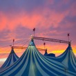 Circus tent in a dramatic sunset sky colorful oran...