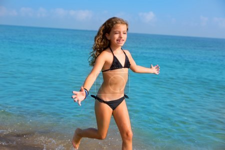 blue beach kid girl with bikini jumping and running