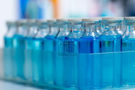 Chemical scientific laboratory blue glass bottles