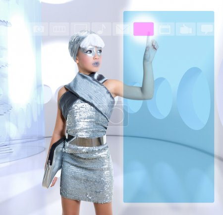 Photo for Futuristic children girl in silver touch finger copyspace glass holographic screen - Royalty Free Image
