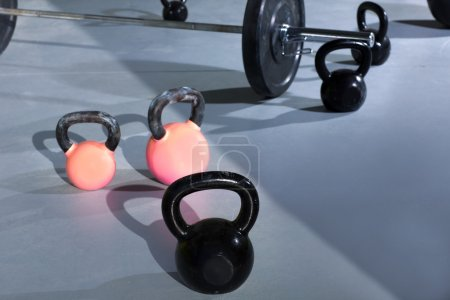 Kettlebells at crossfit gym with lifting bar