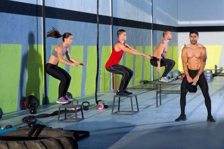 Photo for Crossfit box jump group and kettlebell man at gym - Royalty Free Image