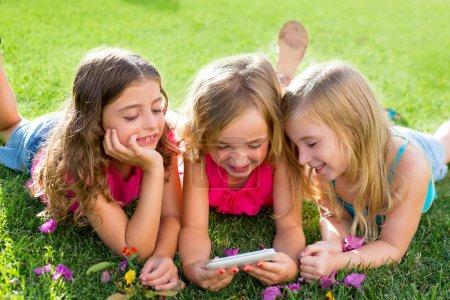 children friend girls playing internet with smartphone