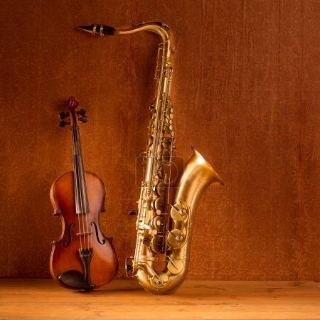 Photo for Classic music Sax tenor saxophone violin in vintage wood background - Royalty Free Image