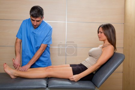 Ankle mobilization therapy of doctor man to patient woman