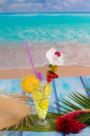 Lemon lime cocktail mojito on tropical beach