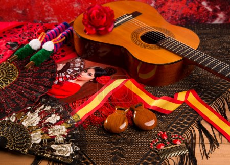 Photo for Classic spanish guitar with flamenco elements as comb fan and castanets - Royalty Free Image