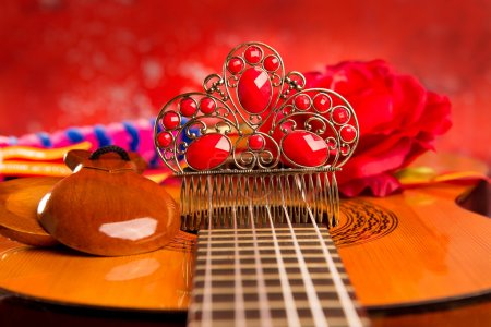 Photo for Classic spanish guitar with flamenco elements as dancer comb and castanets - Royalty Free Image