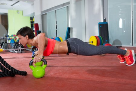 Photo for Crossfit fitness woman push ups Kettlebells pushup exercise at gym workout - Royalty Free Image