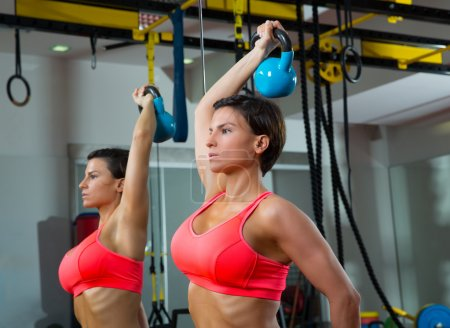 Photo for Crossfit fitness weight lifting Kettlebell woman at mirror workout exercise at gym - Royalty Free Image
