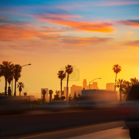 Photo for LA Los Angeles sunset skyline with traffic California from freeway - Royalty Free Image