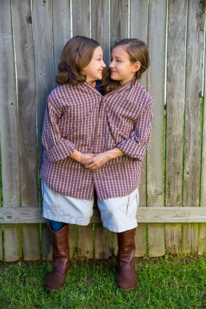 twin girls dressed up as siamese with his father shirt
