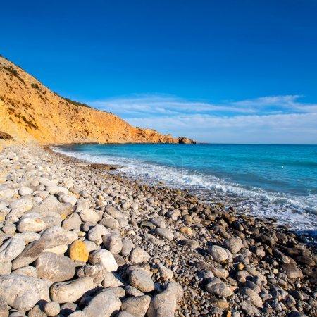 Ibiza Cala Jondal Beach with rolling stones in san Jose