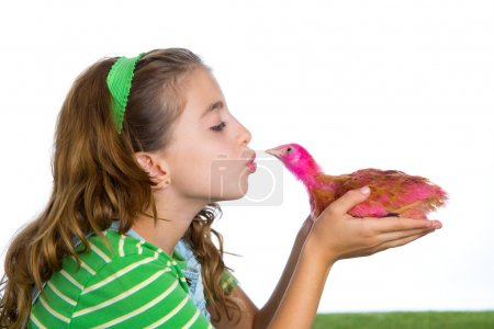 Photo for Breeder hens kid girl rancher farmer kissing a chicken chick white background - Royalty Free Image
