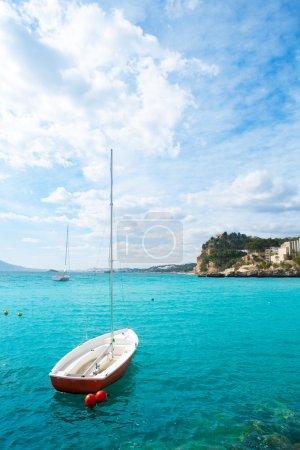 Altea Mediterranean sea detail with sailboat in alicante