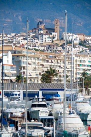 Altea village in alicante with marina boats foreground
