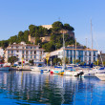 Denia Port with castle hill and marina boats in Al...