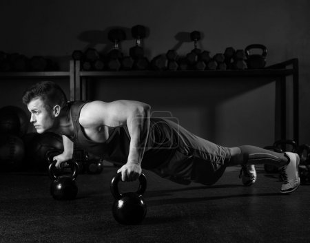 Photo for Kettlebells push-up man strength pushup exercise workout at gym - Royalty Free Image
