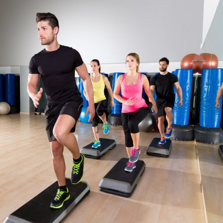 Photo for Cardio step dance people group at fitness gym training workout - Royalty Free Image