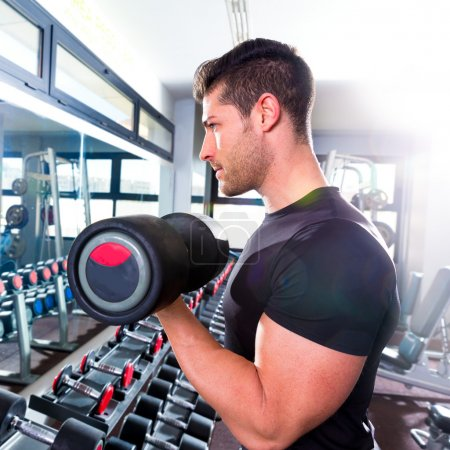 Photo for Dumbbell man at gym workout biceps fitness weightlifting - Royalty Free Image