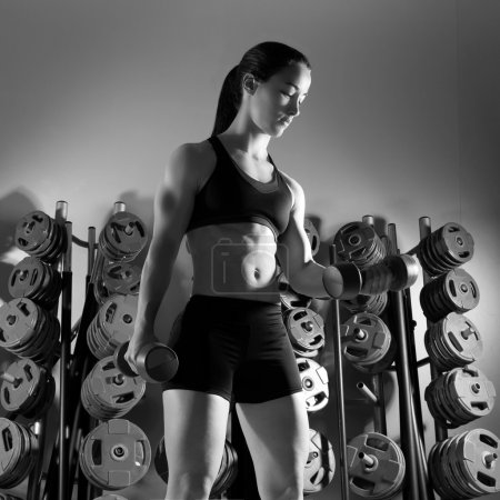 Photo for Dumbbell woman workout fitness club at weightlifting gym - Royalty Free Image