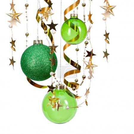 Photo for Christmas green balls with ribbons and stars isolated on white - Royalty Free Image