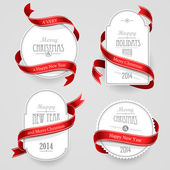 Collection of Christmas emblems with red ribbons on a gray background