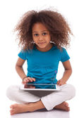 Little african asian girl using a tablet pc