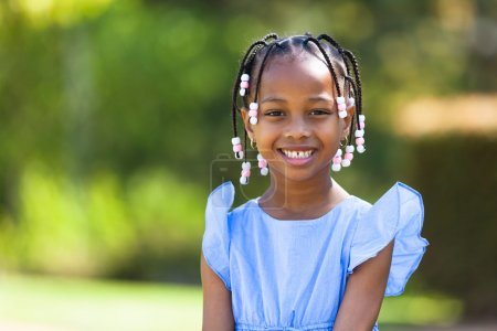 Photo for Outdoor close up portrait of a cute young black girl smiling - African people - Royalty Free Image