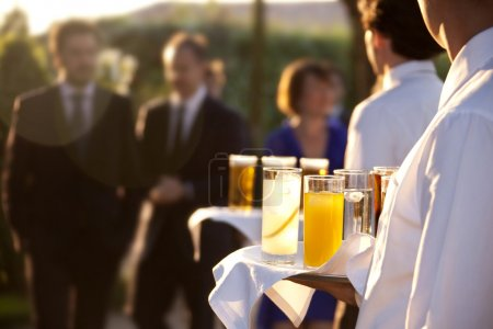 Photo for Professional catering service serving drinks to guests - Royalty Free Image
