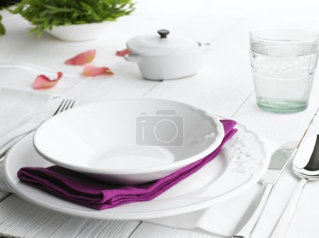 Photo for Romantic place setting on white wooden table - Royalty Free Image