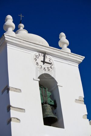 white Christian bell tower