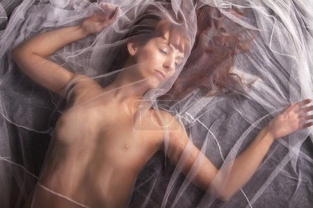 Girl with a transparent cloth