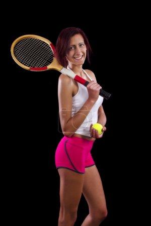 Beautiful young girl  playing tennis