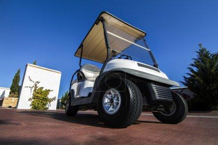 white golf cart parked