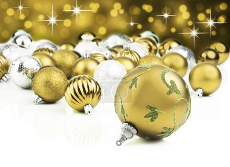 Golden decorative christmas ornaments with star background