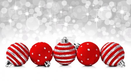 Christmas decoration balls on a star background with space for text