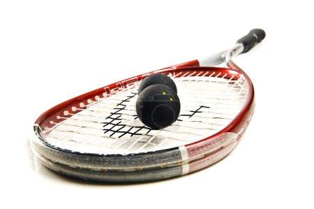 Squash racket and balls