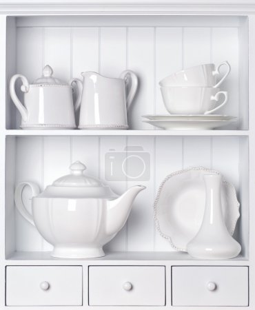 Photo for White shelf with vintage porcelain tableware - Royalty Free Image