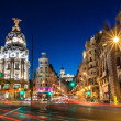Rays of traffic lights on Gran via street, main sh...