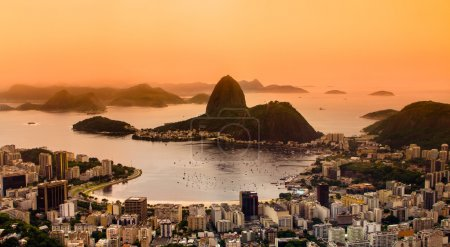 Photo for Rio de Janeiro, Brazil. Suggar Loaf and Botafogo beach viewed from Corcovado at sunset. - Royalty Free Image