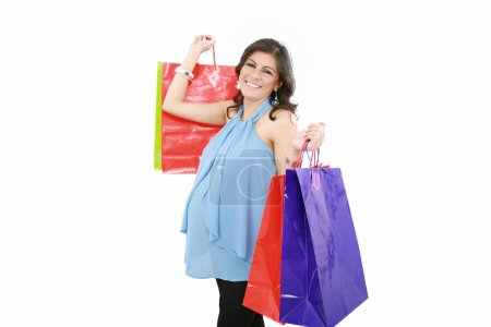 Happy pregnant woman with shopping bags