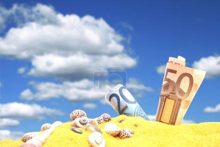Euro money in sand.
