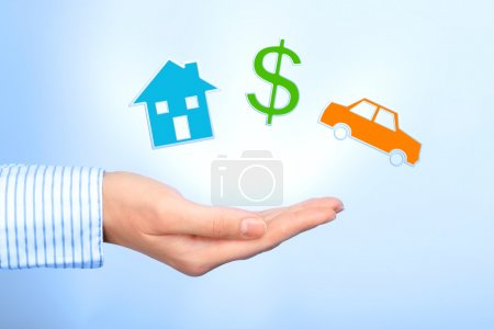 Photo for Dreams. House, dollar symbol and car in hand. - Royalty Free Image