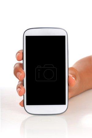 Photo pour Téléphone portable à la main isolé sur blanc . - image libre de droit