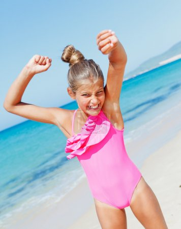 Photo for Beautiful happy smiling girl having fun on the beach. - Royalty Free Image