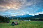 Wooden hut o meadow by Geroldsee lake at sunrise