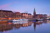 sunset over river in Bremen city