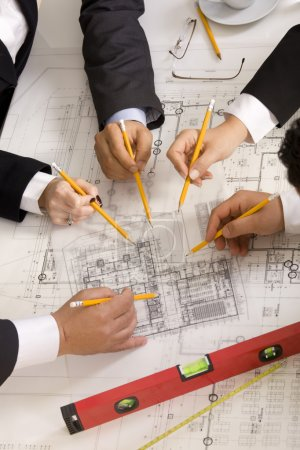 Photo for Meeting the team of engineers working on construction project at the table. Only hands. Up view - Royalty Free Image