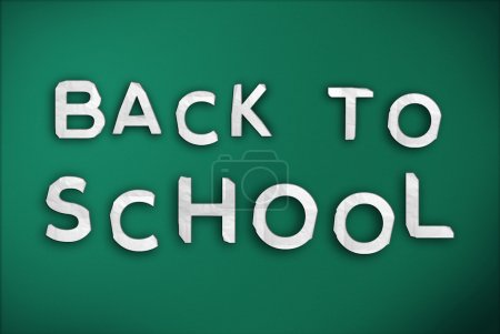 Back to School Text on Green Chalk Board...